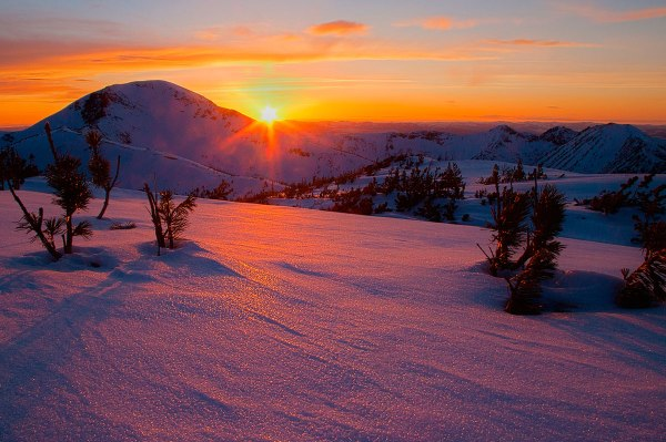 sunset snow mountain photo